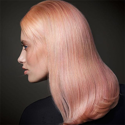 Goldwell Peach/Coral Hair Color Model